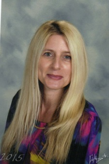 Kara Alesi- Teacher Aid